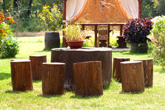 Stump furniture. Stumps used as table and chairs outside in the garden Stock Photos