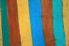 Stump painted bright colored stripes. Rustic style. Cover for br Stock Photo