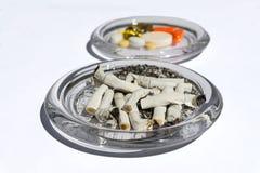 Stumpar och preventivpillerar Arkivbild