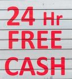 24 Stunden geben Bargeld - die Mitteilung frei, die in Rot geschrieben wird Lizenzfreies Stockbild