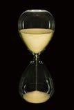 Stunden-Glas auf Schwarzem Stockbild