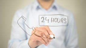 24 Stunden verfügbar, Konzept, Mannschreiben auf transparentem Schirm Stockbilder