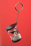 Stundenglas auf einer Schlüsselkette Stockfotografie