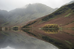 Stuning Autumn Fall landscape image of Lake Buttermere in Lake D. Beautiful Autumn Fall landscape image of Lake Buttermere in Lake District England stock photography