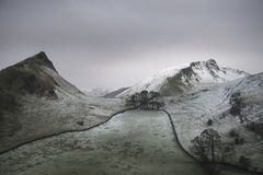 Stuning Winter landscape image of Chrome Hill and Parkhouse Hill. Beautiful Winter landscape image of Chrome Hill and Parkhouse Hill in Peak District England Royalty Free Stock Images
