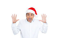 Stunned, amazed handsome christmas man Stock Photo