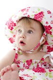 Stunned Baby. Baby surprised  by something perhaps her fathers studio lights Stock Image