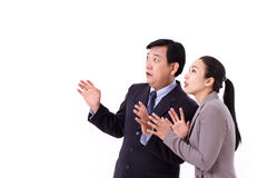 Stunned business team looking up. Isolated Stock Photo