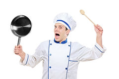 Stunned chef holding kitchen utensil Stock Photography