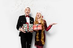 A stunned pair of lovers in Santa Claus hats celebrating the new royalty free stock photo