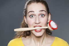 Stunned 20s girl passionate about washing dishes and clean home Stock Photo