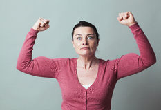 Stunned 40s woman showing her emphasized strength Stock Photo