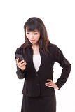 Stunned, surprised, exited businesswoman looking at smartphone Stock Images