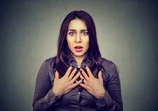 Stunned woman looking at camera Royalty Free Stock Photos