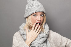 Stunned young blond girl wearing fashionable winter clothes Stock Photo