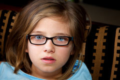 Stunned Young Girl Looks at Camera Stock Photo