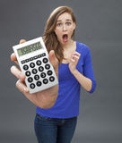 Stunned young woman expressing panic, mistake or shocking financial news Stock Images