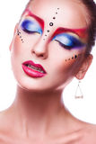 Stunning adult woman with multicolor make up on white background Royalty Free Stock Photography