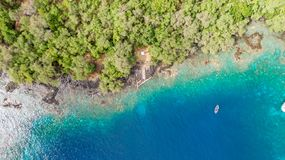 Stunning aerial drone view the Captain James Cook monument in Kealakekua Bay, Big Island, Hawaii. The monument marks the spot wher stock image