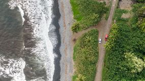 Stunning aerial drone view of a section of the famous Hana Highway south of Hana on the eastern side of the island of Maui, Hawaii. Beautiful black sand beach royalty free stock image