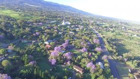 Stunning aerial 4k drone view on countryside town field in sunny summer day mountain hill landscape with clear blue sky stock video footage