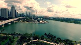 Stunning aerial 4k panorama cityscape view of sunny cloudy day Singapore center modern urban architecture green nature stock footage