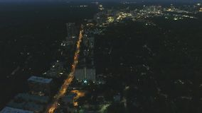 Stunning aerial 4k panorama drone flight view on big busy modern urban Atlanta city skyscrapers in bright night lights. Stunning aerial panorama drone flight stock footage