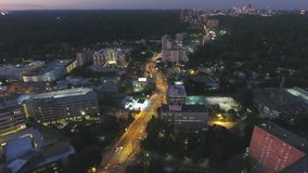 Stunning aerial 4k time lapse drone flight view on big city busy highway road in Atlanta downdown in bright night lights stock video footage