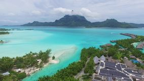 Stunning aerial 4k view on tropical green islands in Bora-Bora French Polynesia in crystal clear turquoise ocean water stock video