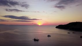 Aerial landscape of sunset on the sea stock video
