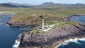 Stunning aerial shot of Ardnamurchan lighthouse with the beautiful white beaches and costline in the background stock video footage