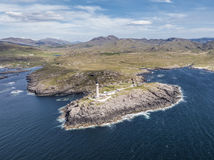 Stunning aerial shot of Ardnamurchan Point, Great Britains most westerly point, with lighthosue and the beautiful white Royalty Free Stock Photography