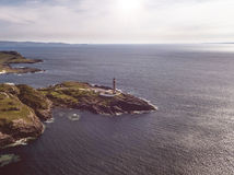 Stunning aerial shot of Ardnamurchan Point, Great Britains most westerly point, with lighthouse and the beautiful white. Beaches and costline in the background Stock Photography