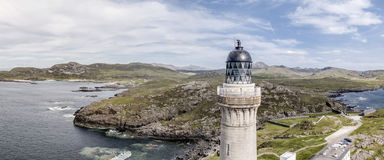 Stunning aerial shot of Ardnamurchan Point, Great Britains most westerly point, with lighthouse and the beautiful white. Beaches and costline in the background Royalty Free Stock Photo