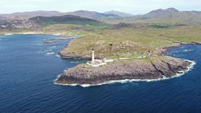 Stunning aerial shot of Ardnamurchan Point, Great Britains most westerly point, with lighthouse and the beautiful white stock footage