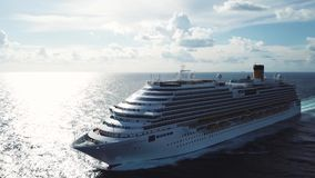 Stunning aerial view of the cruise ship in open water, front view. Stock. Front part of an anchored ocean liner sailing