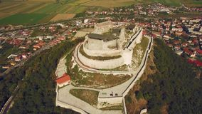 Stunning aerial view of the medieval stone Fortress of Deva atop a hill stock footage