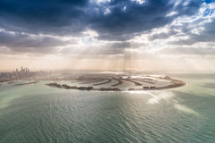 Stunning aerial view of Palm Jumeirah at sunset with sun rays on Stock Image