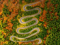 Aerial view of winding road through autumn colored forest. Stunning aerial view of winding road through autumn colored forest Stock Photography