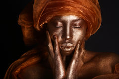Stunning African Amercian Woman Painted With Gold royalty free stock images