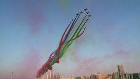 Stunning airshow stunts at Corniche, Abu Dhabi, UAE. National Day. stock photo