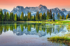 Stunning alpine lake in Dolomites mountains, Antorno lake, Italy, Europe. Amazing sunset and wonderful alpine Antorno lake with high Sorapis mountains group in Royalty Free Stock Images