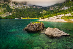 Stunning alpine lake and foggy mountains,Hinterer Gosausee,Austria Royalty Free Stock Photos