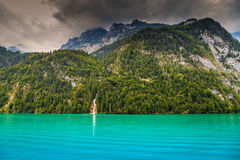 Stunning alpine lake and foggy mountains,Konigsee,Berchtesgaden,Germany,Europe Royalty Free Stock Photography