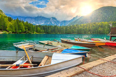 Stunning alpine landscape and colorful boats,Lake Fusine,Italy,Europe Stock Image
