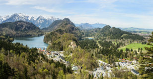 Stunning alpine landscape with glacier lakes,high mountains and Hohenschwangau castle near famous Neuschwanstein castle,Bavaria,Ge Royalty Free Stock Photography