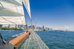 Stunning amazing view of a tall ship nose traveling on the lake toward Toronto downtown Royalty Free Stock Photo