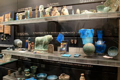Stunning artifacts on display in large glass cases of Egyptian exhibit,The Louvre,Paris,2016 Stock Photography