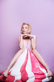 Stunning attractive blonde girl holding big props pink ice cream Stock Photo