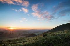 Stunning Autumn sunrise over countryside landscape Royalty Free Stock Image